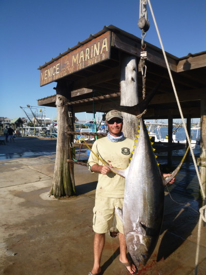 Capt. Charlie Ellis with a trophy yellowfin tuna caught fishing in venice, LA