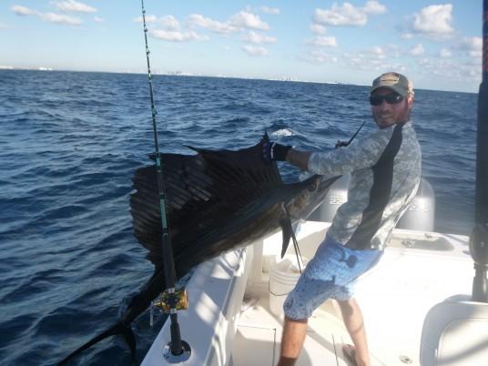 Capt. Charlie Ellis with a Miami Sailfish