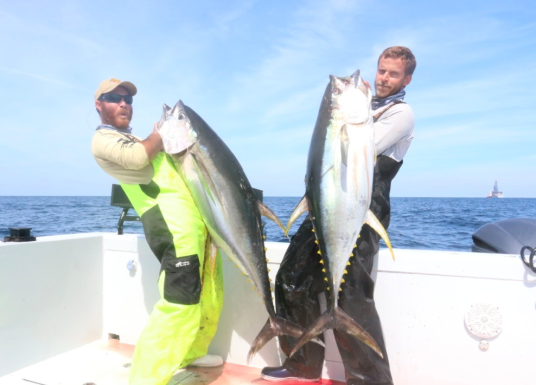 Capt Charlie Ellis with top water yellowfin tuna