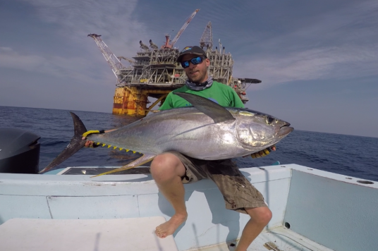Scott Virgin with tuna at oil rig